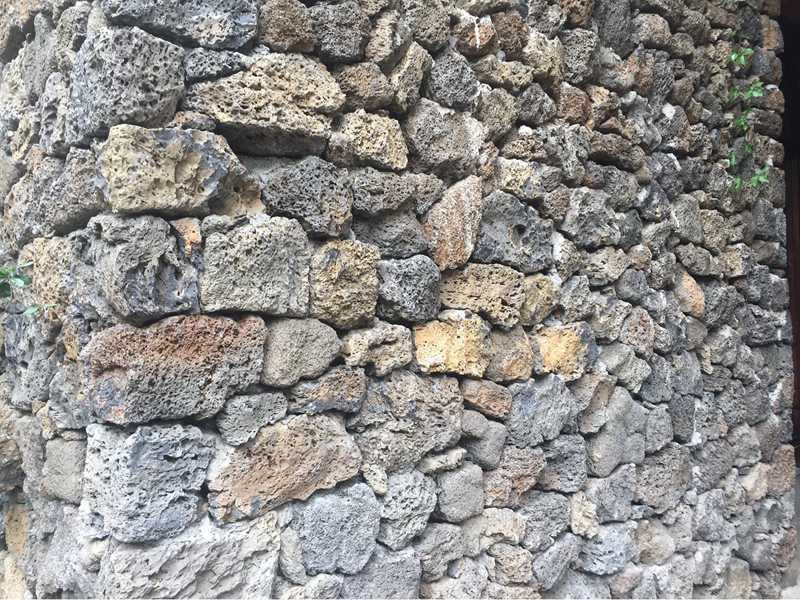 old red lava stone wall